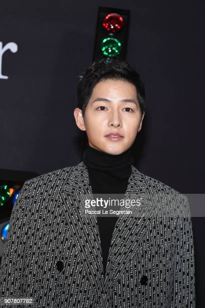 Song Joongki poses at Dior Homme Menswear Fall/Winter 20182019 show as part of Paris Fashion Week at Grand Palais on January 20 2018 in Paris France