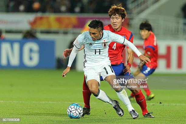 Song Ju Hun of South Korea and Yuya Kubo of Japan in action during the AFC U23 Championship final match between South Korea and Japan at the Abdullah...