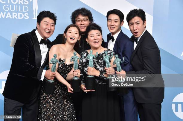 Song Kang Ho Sodam Park director Bong Joonho Jeongeun Lee Woosik Choi and Sunkyun Lee winners of Outstanding Performance by a Cast in a Motion...