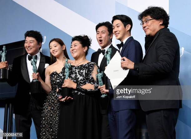Song Kang Ho, So-dam Park, Jeong-eun Lee, Sun-kyun Lee, Woo-sik Choi, and Bong Joon-ho, winners of Outstanding Performance by a Cast in a Motion...