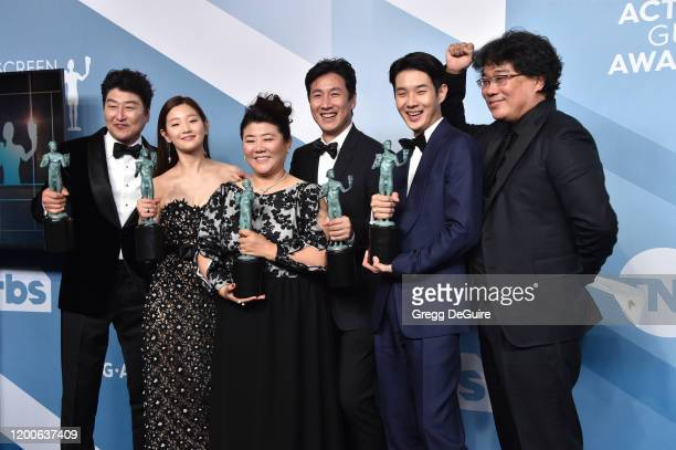 Song Kang Ho Sodam Park Jeongeun Lee Sunkyun Lee Woosik Choi and director Bong Joonho winners of Outstanding Performance by a Cast in a Motion...