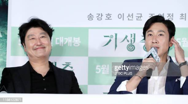 Song KangHo and Lee SunKyun speak during the Press Preview Parasite at Yongsan I'Park Mall on May 28 2019 in Seoul South Korea