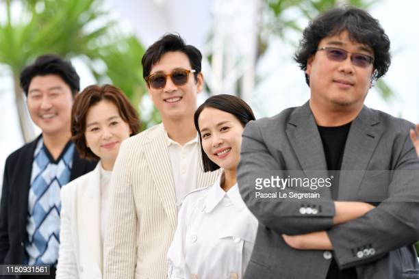 Song Kangho Chang HyaeJin Lee Sungyun Cho Yeojeong and Bong JoonHo attend thephotocall for Parasite during the 72nd annual Cannes Film Festival on...