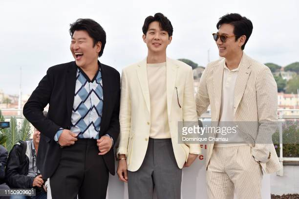Song Kangho Choi Wooshik and Lee Sungyun attend the photocall for Parasite during the 72nd annual Cannes Film Festival on May 22 2019 in Cannes France