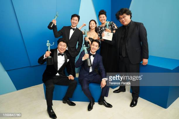 Song Kang-ho, Lee Sun Gyun, Park So-dam, Choi Woo-shik, Lee Jeong-eun, and Bong Joon-ho, winner of the Outstanding Performance by a Cast in a Motion...