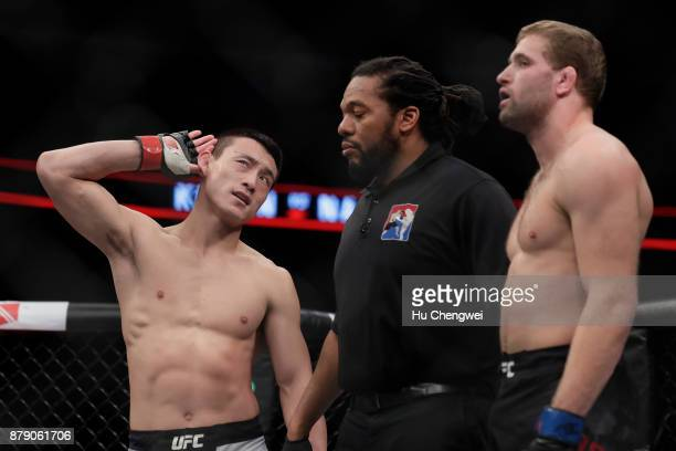 Song Kenan of China left gestures after his victory over Bobby Nash right during the UFC Fight Night at MercedesBenz Arena on November 25 2017 in...