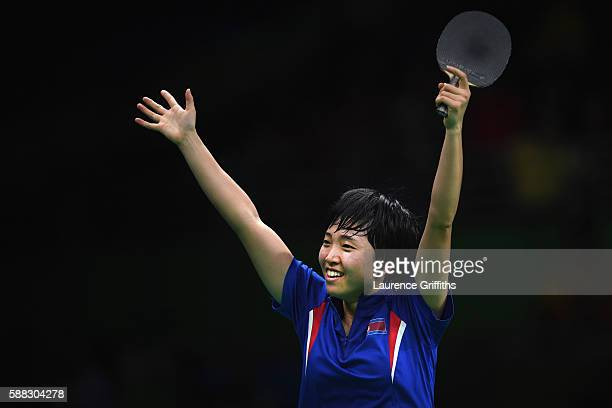 Song Kim of Democratic Peoples Republic of Korea celebrates victory during her Womens Table Tennis Bronze Medal match against Ai Fukuhara of Japan at...