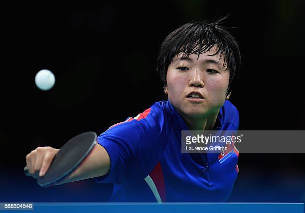 Song Kim of Democratic Peoples Republic of Korea in action during her Womens Table Tennis Bronze Medal match against Ai Fukuhara of Japan at Rio...