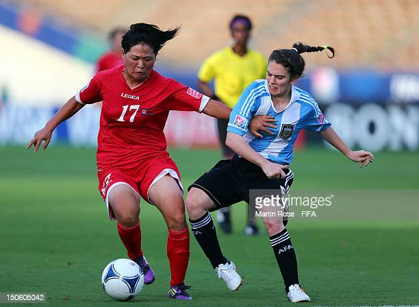 Song Mi Yun of Korea DPR and Camila Gomez Ares of Argentina battle for the ball during the FIFA U20 Women's World Cup 2012 group C match between...