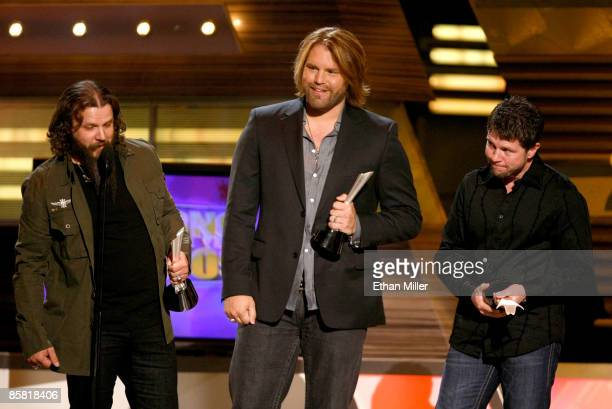 Song of the year award winners Jamey Johnson musician James Otto and composer Lee Thomas Miller speak onstage during the 44th annual Academy Of...