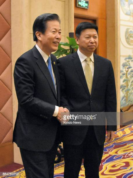 Song Tao head of the Chinese Communist Party's International Department and Natsuo Yamaguchi head of the Komeito Party the coalition partner of...