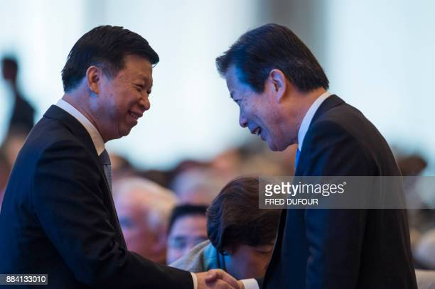 Song Tao Minister of the International Department of the CPC Central Committee greets Natsuo Yamaguchi President of New Komeito Party of Japan during...