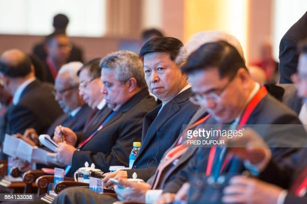 Song Tao Minister of the International Department of the CPC Central Committee waits to give a speech at the CPC in dialogue with world political...