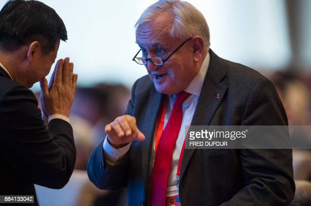Song Tao Minister of the International Department of the CPC Central Committee gestures to French former prime minister JeanPierre Raffarin during...
