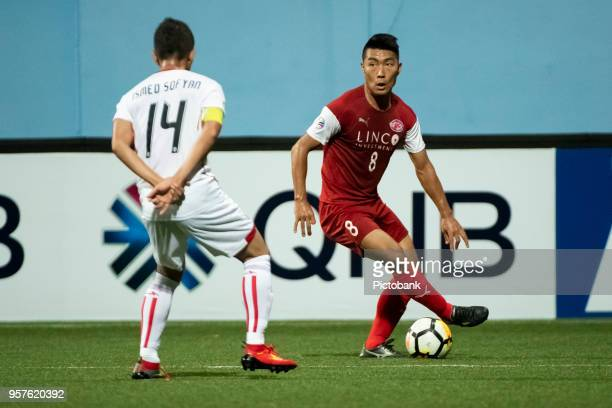 Song UiYong of Home United is challenged by Ismed Sofyan of Persija Jakarta during the AFC Cup Zonal Semi final between Home United and Persija...
