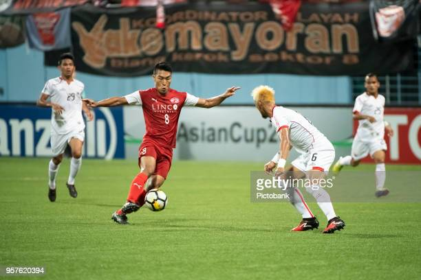 Song UiYong of Home United is challenged by Maman Abdurahman of Persija Jakarta AFC Cup Zonal Semi final between Home United and Persija Jakarta at...
