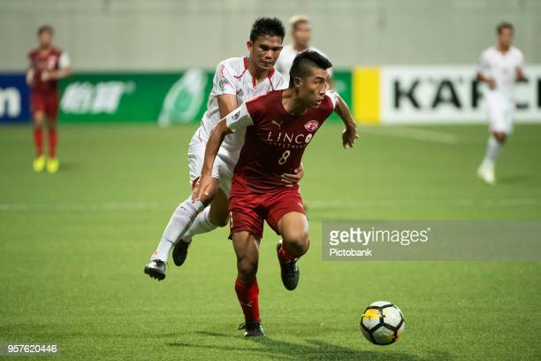 Song UiYong of Home United is challenged by Riko Simanjuntak of Persija Jakarta during the AFC Cup Zonal Semi final between Home United and Persija...