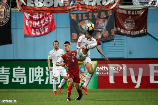 Song UiYong of Home United is challenged by Vava Mario Yagalo of Persija Jakarta during the AFC Cup Zonal Semi final between Home United and Persija...