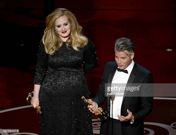 Song writer Paul Epworth and singer Adele Adkins accept the Best Original Song award for Skyfall from 'Skyfall' onstage during the Oscars held at the...