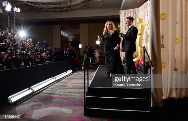 Song writer Paul Epworth and singer Adele Adkins pose with the Best Original Song award for Skyfall from 'Skyfall' in the press room during the...