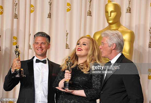 Song writer Paul Epworth singer Adele and actor Richard Gere arrive to the 85th Annual Academy Awards Press Room held at Hollywood Highland Center on...