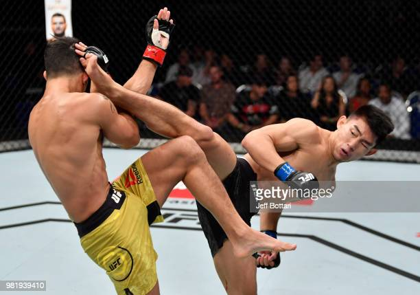 Song Yadong of China kicks Felipe Arantes of Brazil in their bantamweight bout during the UFC Fight Night event at the Singapore Indoor Stadium on...