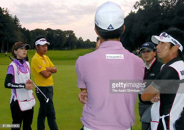 Song YoungHan of South Korea and Yuta Ikeda of Japan are told the rest of playoff is carried over to tomorrow at the final round of the Homna...