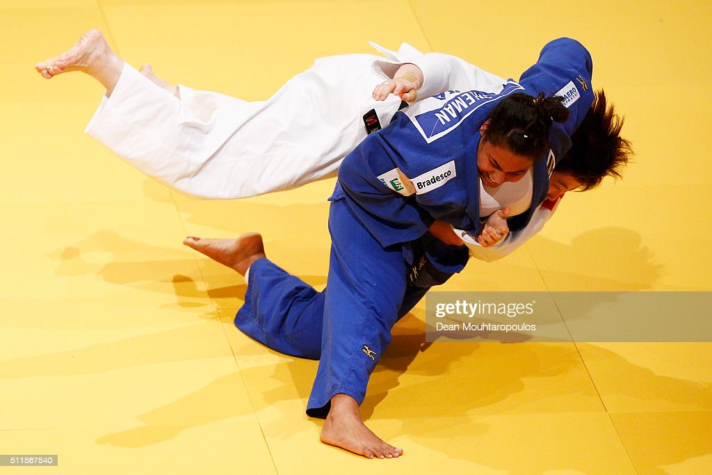 Song Yu (white top) of China and Maria Suelen Altheman of Brazil compete during the Dusseldorf Judo Grand Prix in their Womens +78kg Gold medal match held at Mitsubishi Electric Halle on February 21, 2016 in Dusseldorf, Germany.