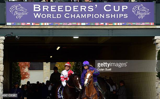 Songbird ridden by Mike Smith leads the horse to the track before the running of the Breeders' Cup Juvenile Fillies during day two of the Breeders'...
