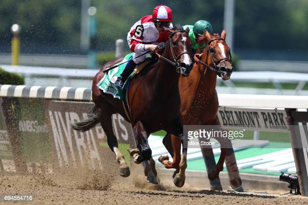 Songbird with Jockey Mike Smith out runs the field to win The Ogden Phipps during the 149th running of the Belmont Stakes at Belmont Park on June 10...