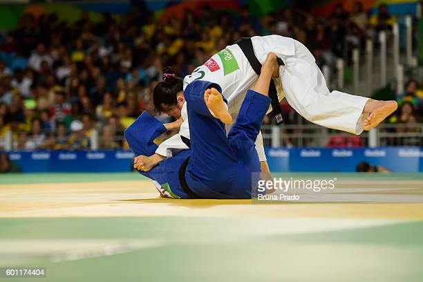 Songlee Jin of South Korea battles with Tong Zhou of China during the Women 63 kg Judo Bronze Medal bout at the Carioca Arena 3 during the Rio 2016...