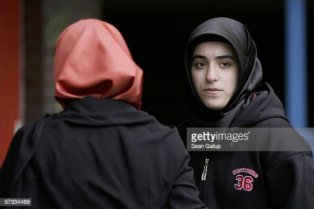 Songol Surucu sister of Alpaslan and Mutlu Surucu waits for her two brothers outside a Berlin courthouse after a court acquitted them in the killing...