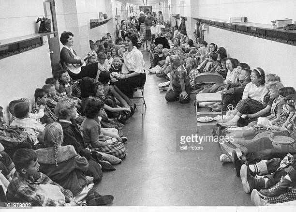 NOV 20 1961 NOV 21 1961 Songs Occupy TwoHour School Drill Music teacher Betty Moorhead plays the guitar and Mary Jo Schulz sings to entertain...