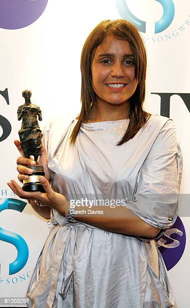Songwriter Amanda Ghost poses in front of the winners' boards with the award for Best Selling British Song for 'Beautiful Liar' at the 53rd Ivor...