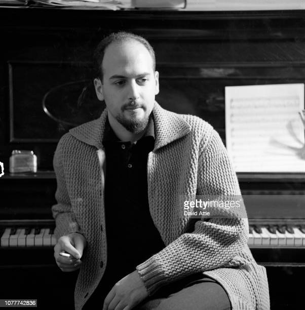 Songwriter and producer Jerry Leiber of the songwriting and producing team Leiber and Stoller poses for a portrait in his apartment in 1959 in New...