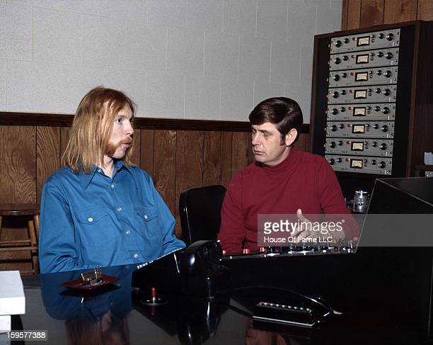 Songwriter and producer Rick Hall and session guitarist Duane Allman at the mixing board at FAME Studios in 1968 in Muscle Shoals Alabama