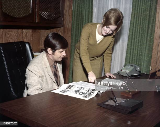 Songwriter and producer Rick Hall chats with secretary Carol Little in his office at FAME Studios in 1968 in Muscle Shoals Alabama