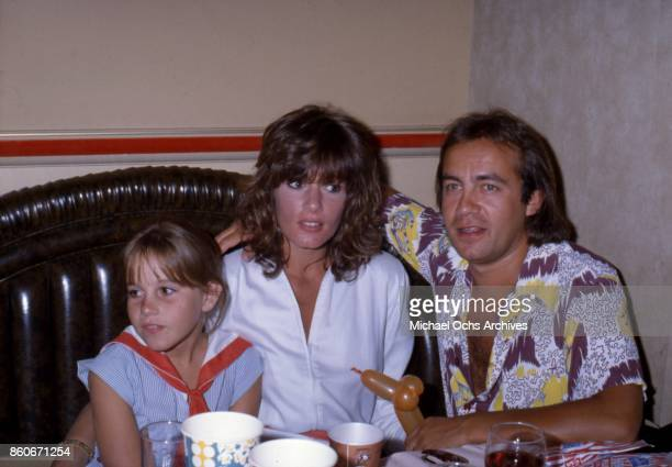 Songwriter Bernie Taupin attends an event with his wife and muse Maxine Feibelman and a young girl in circa 1973