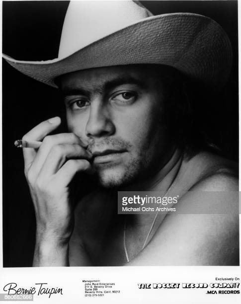 Songwriter Bernie Taupin poses for a portrait in March 1977