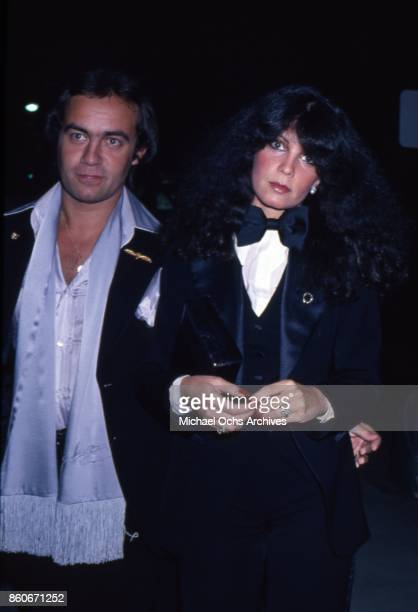 Songwriter Bernie Taupin poses for a portrait with a Bentley car and his wife Toni Lynn Russo at an event in Los Angeles California in circa 1979