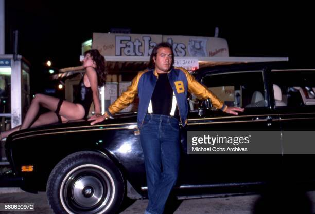 Songwriter Bernie Taupin poses for a portrait with a Rolls Royce car and his wife Toni Lynn Russo outside of Fat Jack's fast food shop on Ventura...