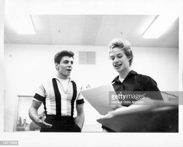 Songwriter Carole King and singer Johnny Restivo chat between takes in a recording studio in New York New York circa 1959