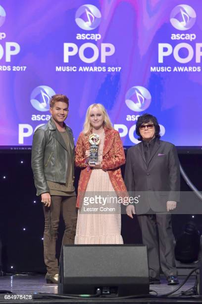 Songwriter Doris Sandberg accepts the award for Songwriter of the Year with singer Adam Lambert and ASCAP EVP of Membership John Titta onstage at the...