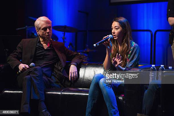 Songwriter drummer producer Bill Rieflin and musician Hollis WongWear speak on stage during the Pacific Northwest Songwriter's Summit at Experience...