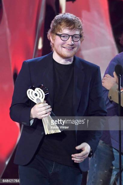 Songwriter Ed Sheeran accepts Best Lyrics for 'Love Yourself' onstage at the 2017 iHeartRadio Music Awards which broadcast live on Turner's TBS TNT...