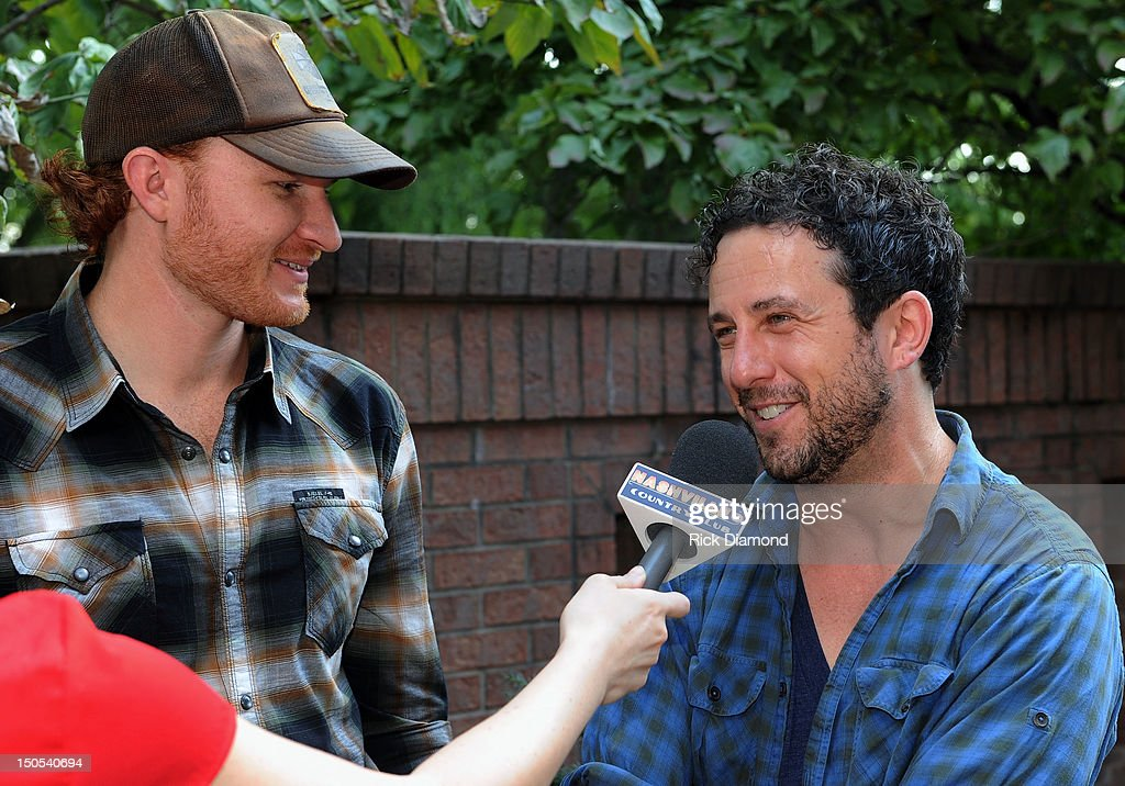 Songwriter Eric Paslay (ASCAP) and Songwriter Will Hoge (BMI) pictured are honored for there #1 hit 'Even if it breaks your heart' recorded by Republic Nashville recording artists Eli Young Band at the CMA offices on August 20, 2012 in Nashville, Tennessee.