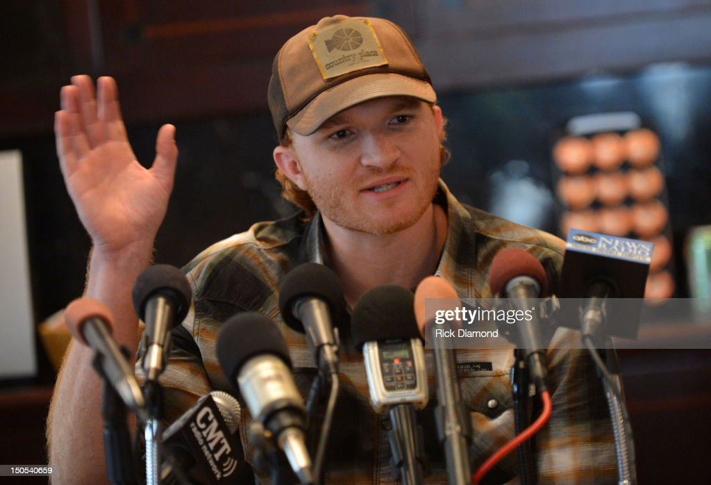 Songwriter Eric Paslay (ASCAP) pictured and Songwriter Will Hoge (BMI) are honored for there #1 hit 'Even if it breaks your heart' recorded by Republic Nashville recording artists Eli Young Band at the CMA offices on August 20, 2012 in Nashville, Tennessee.