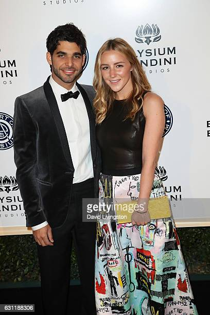 Songwriter Freddy Wexler and Olivia Zaro arrive at The Art of Elysium presents Stevie Wonder's HEAVEN celebrating the 10th Anniversary at Red Studios...