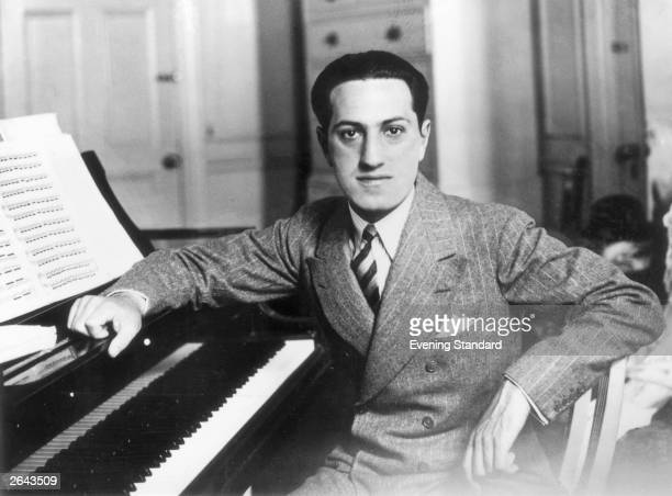 Songwriter George Gershwin at a piano