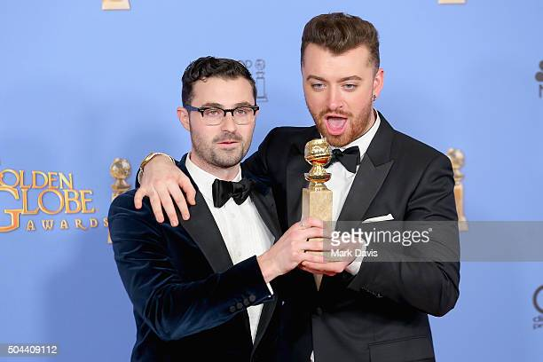 Songwriter Jimmy Napes and recording artist Sam Smith winners of Best Original Song Motion Picture for 'Writing's On the Wall' in Spectre pose in the...